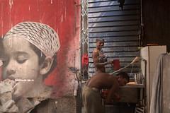 CALC_5807 Shower in the street (rose.vandepitte) Tags: india kolkata streetphotography streetscene streetlife boys shower poster havingfun red nikond750 35mmlens fun playing