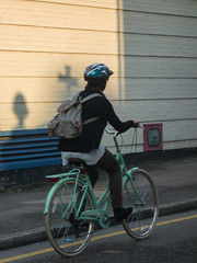 261/365 - Christ on a bike? (Spannarama) Tags: road uk woman sunlight london church sunshine bike wall vent cyclist shadows cross pavement 365 firehose ec1 2014 lambsbuildings