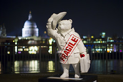 Fragile Paddington Bear on the Bank of the Thames with St Pauls in the Background. London at Night (iesphotography) Tags: city uk greatbritain travel bridge houses red england urban building bus london tower english history clock tourism westminster thames architecture canon vintage outdoors big exterior place ben unitedkingdom britain grunge united traditional famous capital transport culture kingdom parliament bigben landmark scene icon palace tourist retro spire national government historical british paddingtonbear redbus paddingtonlondon 1dx bearlondon paddingtonbearlondon canon1dx paddingtondisplay