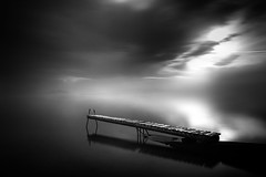 Stillness (ilias varelas) Tags: longexposure sea blackandwhite bw seascape black water monochrome clouds canon mono pier mood greece ilias canonef1740mmf4l varelas canoneos6d