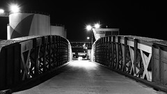 de l'autre côté (intemporelbybb) Tags: bridge light blackandwhite bw monochrome night noiretblanc nb pont nuit saintnazaire passerelle loireatlantique chantiernaval flickrchallengegroup