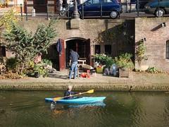Sunshine on the Oudegracht (indigo_jones) Tags: autumn holland fall water netherlands sunshine painting canal utrecht kayak artist herfst nederland wharf restoration levels kelder oudegracht werf