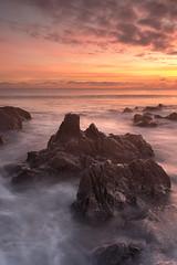 Rocky Sunset (paulflynn) Tags: sea sun seascape landscape evening rocks seascapes ballycroneen