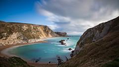 Man o' War Cove III (Nigel Jones QGPP) Tags: longexposure sea clouds azure dorset opal lulworth durdledoor manowarcove