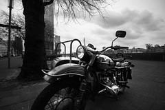 old bike (bjdewagenaar) Tags: trees sky urban bw white black classic bike clouds vintage buildings raw angle sony wide sigma motorbike alpha 1020mm lightroom a58 10mm