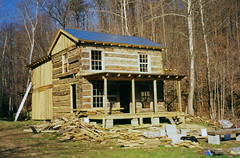 Isaac Bolt Log House — Boyd County, Kentucky (Pythaglio) Tags: county blue trees windows roof house mountain film metal farmhouse standing altered photo spring log kentucky isaac hill logs fork 1999 66 historic porch bolt scanned bolts moved ladder residence boyd twostory seam slope exposed addition rafters reconstructed dwelling topography relocated hewn chinking notching daubing hewed threebay halfdovetail ca1814
