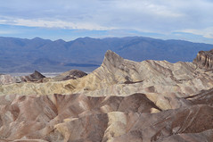 Death Valley (Laurie Taylor.) Tags: travel wild summer cliff usa rock america death sand nikon rocks desert valley wilderness