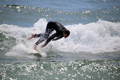 A surfer is knocked off his board while surfing off Manasquan Beach. (apardavila) Tags: surf waves surfer surfing jerseyshore atlanticocean manasquan manasquanbeach