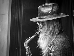 The Sound Of Music (Leanne Boulton) Tags: life street city uk light shadow portrait people urban blackandwhite bw musician music white man black detail male art texture monochrome face hat closeup canon hair beard 50mm mono scotland living blackwhite natural humanity outdoor expression glasgow candid character culture streetphotography style streetlife scene human shade portraiture soul 7d busker performer society sax tone facial saxophone stylish candidportrait candidstreetphotography