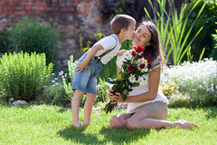 Beautiful kid and mom in spring park, flower and present. Mothers day celebration concept (Cneyt Gen) Tags: kid gift baby park green flowers copy white spring hat kiss boy day concept happiness holiday summer playing outside casual people vertical hiding female smiling love portrait family box lifestyle young girl surprise face woman person outdoors mothers beautiful child space nature giving present happy rose daisy