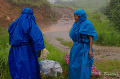 When you must work outdoors in the rainiest place on earth, this is what you wear. (stevebfotos) Tags: cherrapunjee meghalaya topaz people woman rain cherrapunjeetrip india in