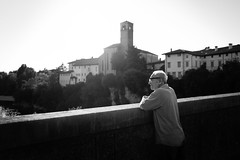 Memories of light (Giulio Magnifico) Tags: beauty man 28mm thinking udine dreams street blackwhite emotions friuli beautiful lighting cividale bw powerful memories italy horizon classic soul streetphotography artist candid leicaq soulful bridge light leica