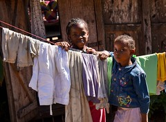 Washing Girls (Rod Waddington) Tags: africa african afrika afrique madagascar malagasy girls group two clothes washing line home house backyard female portrait people culture ethnic village villager