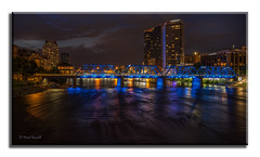 Downtown Nightfall 4 (Mark Darnell) Tags: grandrapidsmi bridge cityskyline nightphotos place structure sonyalpha gmaster longexposure citylights river grandriver blue jwmarriotthotel