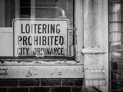 Loitering Prohibited (tim.perdue) Tags: loitering prohibited city ordinance sign london ohio downtown small town urban decay window reflection peeling paint brick glass abandoned vacant empty black white bw monochrome