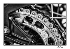 Chain (Artico7) Tags: chain wheel transmission ktm spokessteel metal speed austrian bw blackwhite blackandwhite biancoenero catena monochrome ruota trasmissione fuji xe1