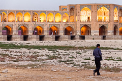 Man walking beside Khaju Bridge in Isfahan, Iran (damonlynch) Tags: people man male men nature water weather river walking religious person persian scenery adult iran dusk masculine walk muslim islam religion middleeast rocky dry places drought riverbed shia iranian adults barren esfahan humans isfahan nightfall drying middleeastern humanbeings shiite zayandehriver isfahanprovince zayandehrud khajubridge polekhaju twelver shiaislam imamishiaislam imamishīaislam