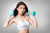 Healthy hispanic young asian woman with dumbbells working out (Patrick Foto ;)) Tags: portrait people woman white cute girl beautiful beauty smile sport female training studio asian fun thailand happy person grey healthy holding pretty slim adult exercise body background working young lifestyle health thai attractive strong concept cheerful workout fitness gym weight isolated fit sporty active lifting dumbbell