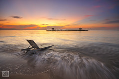 Relax and take breath (Shahrulnizam KS) Tags: morning sea sky bali moon beach monument rock sunrise indonesia relax island dawn sand chair silent slow object tranquility line shutter lead leading tranquil asean silky sanur karang shahrulnizamks
