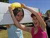 100710.047. Wet Sponge. (actionsnaps) Tags: girls friends water smiling laughing children kent sunny squeeze stocks familyfun captive fundraising margate enjoyment wethair playmates baseballcap thanet restrained charityevent summerfair pillory wetsponges northdownprimaryschool tenterdenway
