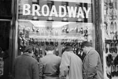 Three men and a woman looking at window display at Broadway shoe store, Melbourne (State Library Victoria Collections) Tags: signs sign australia melbourne victoria 1950s signage shops vic 1960s 1970s 1980 1980s 1950 statelibraryofvictoria statelibraryvictoria buildingsigns markstrizic