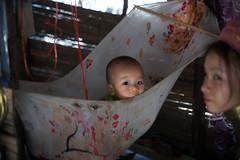 Child in a hammic (Honest Dan Photography) Tags: portrait canon neck thailand 50mm long village child hill karen f tribe 18 6d hammic