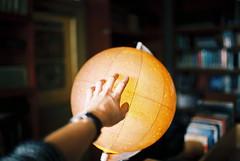 touch the stars (janamartish) Tags: light sky film analog 35mm canon stars photography globe hand kodak library touch books 100 analogue ektar 1000n