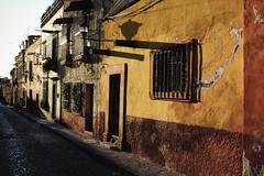 Calle (Maria Sciandra) Tags: street texture yellow architecture facade mexico shadows cobblestones urbanexploration sanmigueldeallende weathered goldenhour colonialmexico fujifilmx100 mariasciandraphotography