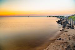 Deal Island Coastline at Sunset (Robchaos) Tags: ocean longexposure sunset sea beach water beautiful landscape island coast sand nikon colorful dusk jetty shoreline maryland easternshore shore somersetcounty ndfilter dealisland colorfulsunset tokina288028 d700