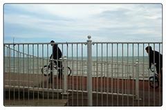 bikes and railings by the sea (EwaHB) Tags: hastings seaside sea ocean railings bike bikeriders sky cycle ride riders