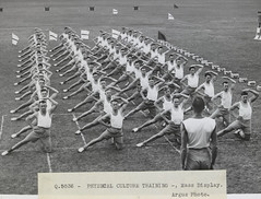 """""""The Army maintains a special school at Frankston ... More than 700 qualified P.T. [i.e. physical training] instructors have been trained for the A.I.F. and home defence forces."""" (State Library Victoria Collections) Tags: training army exercise 1940s workout stretching troops 1941 fit classes stretches exercising statelibraryofvictoria"""
