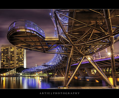 The Helix Bridge in Marina Bay, Singapore (II) :: HDR (:: Artie | Photography ::) Tags: bridge reflection building art metal architecture modern night photoshop canon landscape lights landscapes singapore skyscrapers steel tripod pedestrian wideangle helix complexity ef 1740mm hdr stainless artie cs3 marinabay 3xp f4l photomatix tonemapping helixbridge tonemap 5dmarkii 5dm2