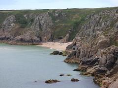 Porthcurno Bay, Cornwall (milnefaefife) Tags: sea seascape beach landscape coast sand rocks cornwall cliffs shore swimmers porthcurno treen holidaymakers naturists loganrock porthcurnobeach