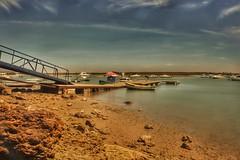 Boats... (hobbit68) Tags: old sunset sky holiday beach clouds strand boats alt urlaub himmel wolken playa boote andalucia espana sonne spanien steg sonnenschein