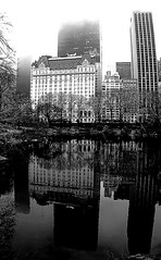 Urban Reflection (sinbadcc1) Tags: nyc bw newyork buildings reflections pond cityscape centralpark