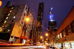one night on a'beckett street (mugley) Tags: urbanlandscape night longexposure evening wideangle cityscape streetscape buildings architecture towers skyscrapers my80 empiremelbourne apartments crane construction liftcore unilodge citytriumph shopfront heritage bricks walls windows streetlamps starbursts cars parked road lighttrails bluehour sky perspective keystoning flare ghosts artefacts city urban abeckettst cbd melbourne victoria australia nikon d300 nikond300 digital dslr tokina 1224 tokina1224mmf4atxpro tokinaaf1224mmf4 ultrawide zoom 12mm iso200 f16 15s