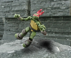 Raph leaps into action (CR1965) Tags: turtlekingdom tmnt teenagemutantninjaturtles revoltech raphael comics collectortoys dollcollecting