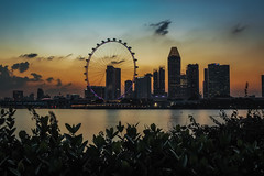 Sundown (elenaleong) Tags: tgrhusunset sundown singapore marinareservoir buildings landmark singaporeflyer