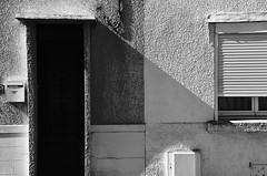 t (Jean-Luc Lopoldi) Tags: bw noiretblanc soleil contraste lumiredure mur maison ville rue street crpi ombre porte volet door t summer shutter pebbledash