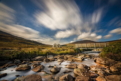 Old mining hut in Wicklow mountains, Ireland (Wojtek Piatek) Tags: ireland wicklow europe 2016 september october autumn river ruins mountains hills hike travel photography landscape rocks bridge old sony a99 zeiss long exposure clouds movement golden hours blue dublin nd filter water