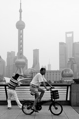 Chinese Fitness (TheWanderingAmerican) Tags: china street blackandwhite white black bike bicycle river blackwhite shanghai streetphotography stretch  workout pudong fitness  bund fitzharris active  huangpu orientalpearltower shanghainese       huangpudistrict