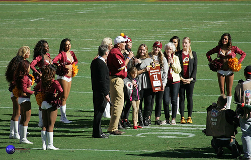 Former Redskins QB Mark Rypien and family during Ring of Fame ceremony.