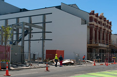 Lots of Work to do Yet! (Jocey K) Tags: street city trees newzealand christchurch sky people building architecture construction cbd buildingsite roadcones isaactheatreroyalrebuild