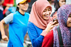 Got a happy message (Luqman Agung W) Tags: girl smile happy expression candid hijab malang sms cfd carfreeday ekspresi ngalam behel ijencarfreedaymalang