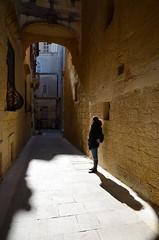 Walking around Mdina - Malta (Giuseppe Finocchiaro) Tags: light shadow people woman donna shadows ombra malta ombre persone luce rabat mdina