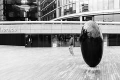 Riverside (lorenzoviolone) Tags: england blackandwhite bw streetart london art monochrome blackwhite unitedkingdom cityhall streetphotography stranger finepix fujifilm streetphoto queenswalk londoncityhall fav10 agfascala200 mirrorless vsco streetphotobw vscofilm fujix100s x100s fujifilmx100s travel:uk=londonapr16