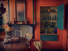 Interior of an old dutch house (STEHOUWER AND RECIO) Tags: old blue red stilllife house holland green history netherlands kitchen lamp table mirror chair cross cabinet antique interior nederland stilleven cups drawer lamps cloth typical enkhuizen vases geschiedenis zuiderzeemuseum