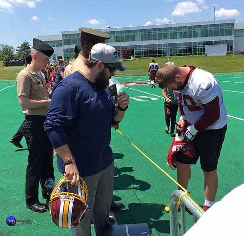 Redskins Center Kory Lichtensteiger Redskins signs autographs on opening day of OTAs for the military.