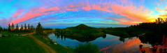 Panoramic sunset and reflections (peggyhr) Tags: pink blue trees sunset panorama orange lake canada green yellow clouds reflections c hills alberta peggyhr bluebirdestates