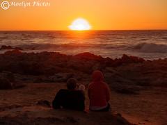 Alpenglow-Watching the Sunset-Asilomar State Beach-Pacific Grove (moelynphotos) Tags: sunset alpenglow seascape pacificocean ocean twopeople watching settingsun beach shore waves surf poundingsurf sun horizon landscapeformat moelynphotos
